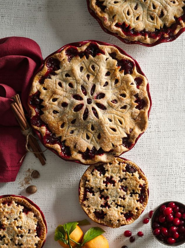 A stunning cranberry pie topped with a snowflake pie crust