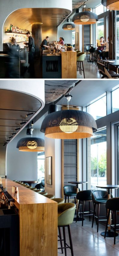 The bar in this modern restaurant appears to be set into a curved niche,…