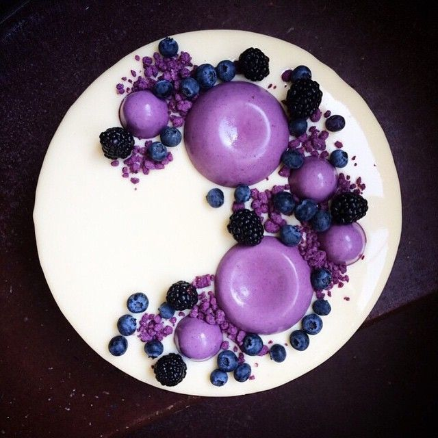 White chocolate and vanilla mousse, chocolate sponge, and blueberry and blackberry panna cotta by…