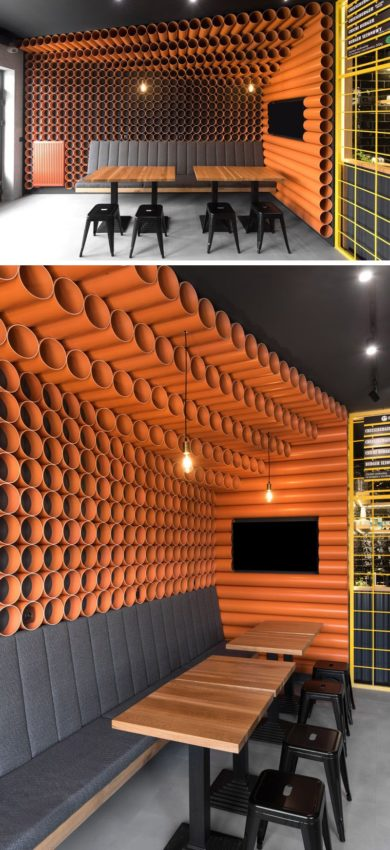 This modern restaurant features almost 300 bright orange PVC pipes that cover the walls…