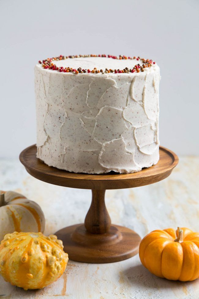 This brown butter pumpkin cake has three layers of moist pumpkin cake frosted with…